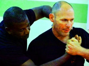 Krav Maga instructor Amnon Darsa demonstrates the correct way to 'pluck' someone's grip away from the throat'.
