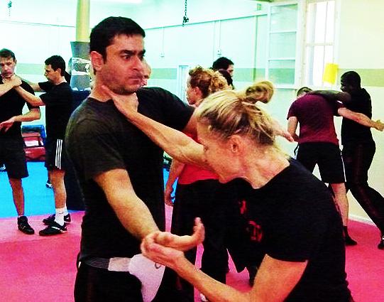 Krav Maga technique, body defense using counter choke and grab.
