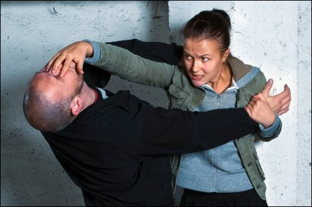 Krav Maga technique: Female defender goes for a face hit/eye gauge with a male attacker.